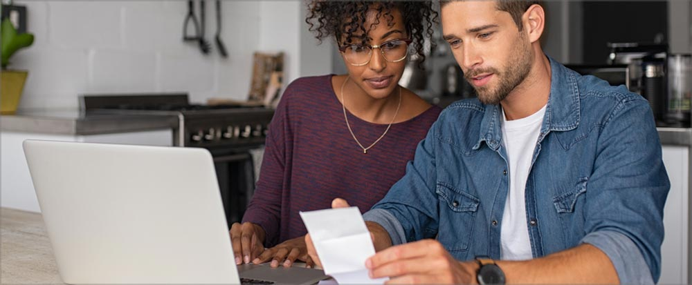 couple reviewing auto loan documents